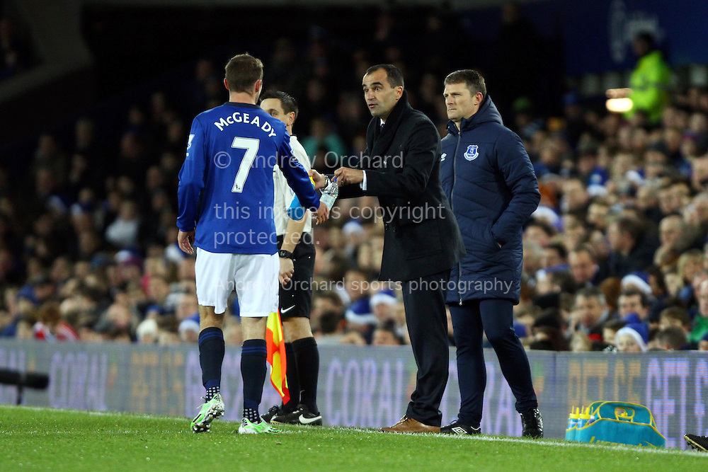Everton Manager Roberto Martinez passes on water and instructions to Aidan McGeady of Everton. Barclays Premier league match, Everton v Queens Park Rangers at Goodison Park in Liverpool, Merseyside on Monday 15th December 2014.<br /> pic by Chris Stading, Andrew Orchard sports photography.