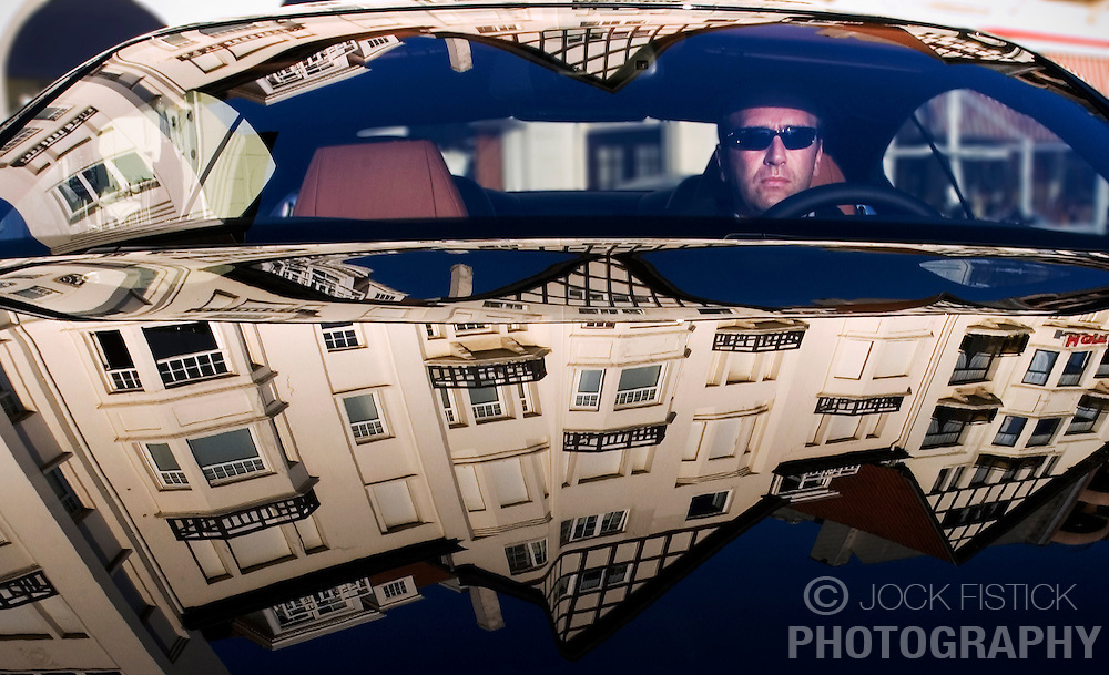 """Reportage for Paris Match Belgium<br /> <br /> A Bentley cruises Albertplien, the main plaza in Knokke where people often circle in their flashy automobiles. The plaza is known to locals as  """"Place M'as tu vu?"""" (Did you see me?). <br /> <br /> Knokke is Belgium's version of the Hamptons, an exclusive community on the North Sea, where the well-heeled come to play and be seen. (Photo © Jock Fistick)"""