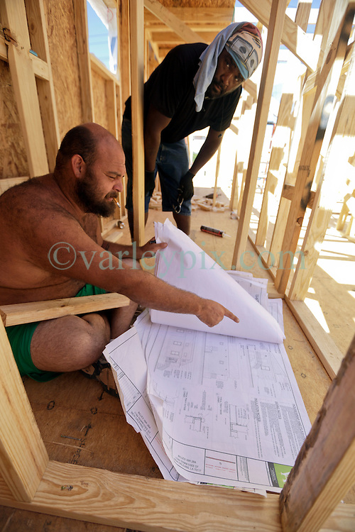 26 August 2015. New Orleans, Louisiana. <br /> Hurricane Katrina revisited. <br /> Rebuilding the Lower 9th Ward. <br /> Site foreman Daniel Reyes oversees the first phase of construction for another eco friendly 'Make it Right' house on Tennessee Street.  'Make it Right' homes inspired by actor Brad Pitt continue to provide hope for the rebirth of the community following the devastation of hurricane Katrina a decade earlier.<br /> Photo credit©; Charlie Varley/varleypix.com.