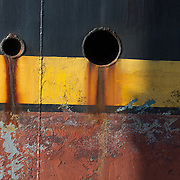Gloucester, MA, USA, March 22, 2015 — An old fishing trawler docked in the harbor is in need of a paint job.