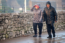 © Licensed to London News Pictures. 31/10/2020. Porthcawl, Bridgend, Wales, UK. <br /> People battle against strong winds and rain in he small Welsh seaside resort of Porthcawl in Bridgend, UK. Photo credit: Graham M. Lawrence/LNP