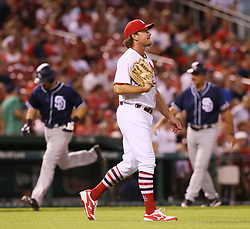 August 22, 2017 - St Louis, MO, USA - St. Louis Cardinals pitcher Zach Duke returns to the mound after allowing a three-run home run to San Diego Padres' Austin Hedges, background left, in the seventh inning on Tuesday, Aug. 22, 2017, at Busch Stadium in St. Louis. The Padres won, 12-4. (Credit Image: © Chris Lee/TNS via ZUMA Wire)