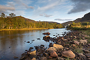 View of the River Leven, upstream, from just outside Kinlochleven, in the Scottish Highlands, on an evening in early autumn.