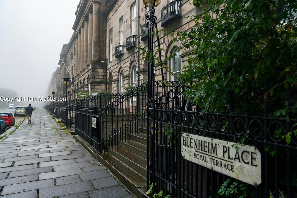 View along Royal Terrace upmarket street on rainy day in Edinburgh, Scotland, UK