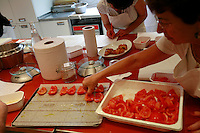 """Lenotre Ecole Culinaire, Paris,..short course - """"Return to the Market"""" with Chef Jacky Legras.working with tomatoes for the confite...photo by Owen Franken for the NY Times..July 12, 2007......."""