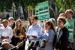 "© Licensed to London News Pictures. 27/06/2018. London, UK. Rebecca Steinfeld (centre-right) and Charles Keidan (centre), who have ""deep-rooted"" ideological objections to the institution of marriage, speak to the press after Supreme Court judges ruled in their favour in their legal battle to grant heterosexual couples the right to enter into civil partnership. Photo credit: Rob Pinney/LNP"