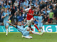 Arsenal's Danny Welbeck tussles with Manchester City's Nicolas Otamendi during the FA Cup Semi Final match at Wembley Stadium, London. Picture date: April 23rd, 2017. Pic credit should read: David Klein/Sportimage