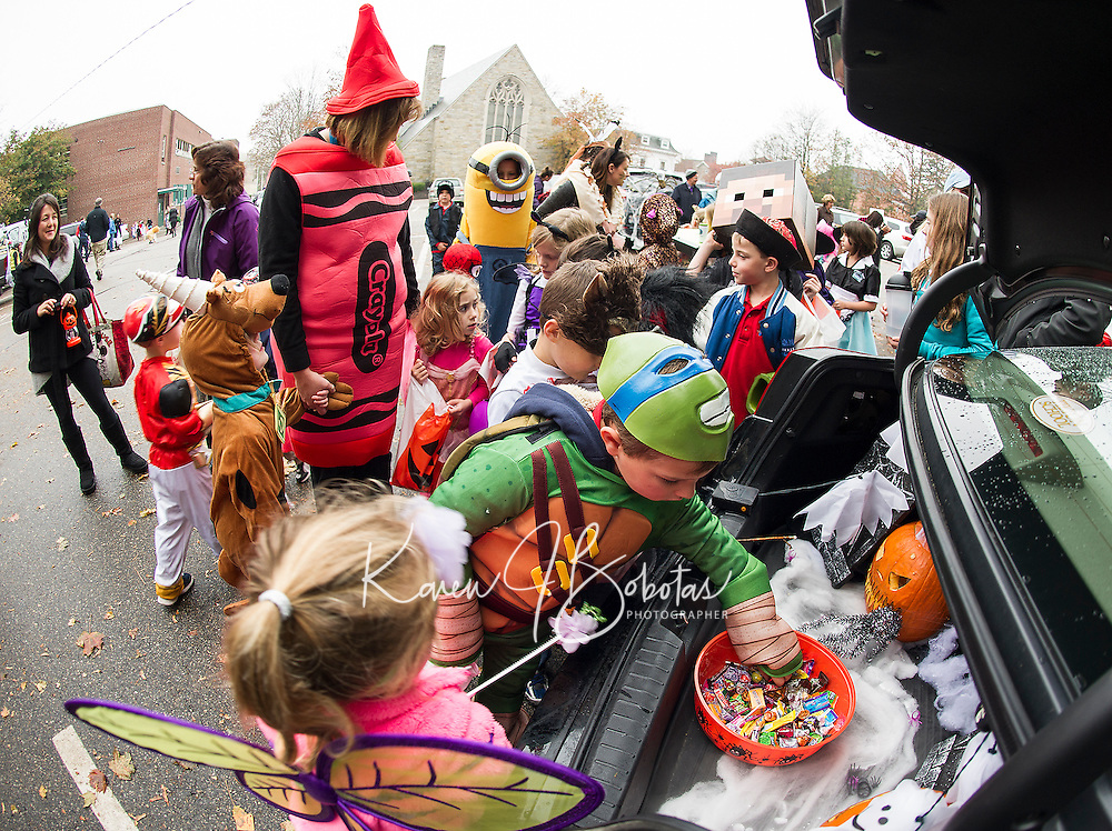 """Mrs. Perry and her pre Kindergarten students go """"trick or trunking"""" in Meredith Kelley's trunk during Holy Trinity's Halloween parade Thursday afternoon.  (Karen Bobotas/for the Laconia Daily Sun)"""