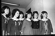 Girls from Belfast and Derry watch the competitors in the Irish Dancing Championships..21.02.1965