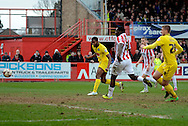 Zak Ansah heads home the third goal during the Sky Bet League 2 match between Cheltenham Town and Plymouth Argyle at Whaddon Road, Cheltenham, England on 28 March 2015. Photo by Alan Franklin.