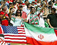 Photo: Chris Ratcliffe.<br /> <br /> Iran v Angola. FIFA World Cup 2006. 21/06/2006.<br /> <br /> Iranian fans show the peace sign with an American flag.