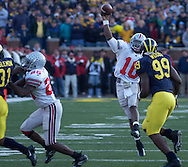 MORNING JOURNAL/DAVID RICHARD.Quarterback Troy Smith completes a first-down pass last in the fourth quarter to set up the Buckeyes' winning score.