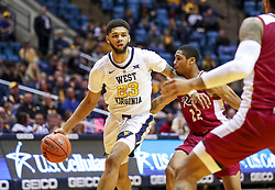 Nov 28, 2018; Morgantown, WV, USA; West Virginia Mountaineers forward Esa Ahmad (23) dribbles the ball during the second half against the Rider Broncs at WVU Coliseum. Mandatory Credit: Ben Queen-USA TODAY Sports