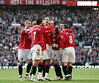 Photo: Paul Thomas.<br /> Manchester United v Manchester City. The Barclays Premiership. 09/12/2006.<br /> <br /> Louis Saha and Man Utd celebrate his goal.