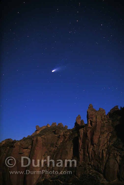 Comet hale-Bopp in the northern sky with moonlight on rock outcrops in Smith Rocks State park, Oregon. Spring 1997