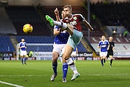 Ben Mee of Burnley clears the ball under pressure from Daryl Murphy of Ipswich Town. Skybet football league Championship match, Burnley v Ipswich Town at Turf Moor in Burnley, Lancs on Saturday 2nd January 2016.<br /> pic by Chris Stading, Andrew Orchard sports photography.