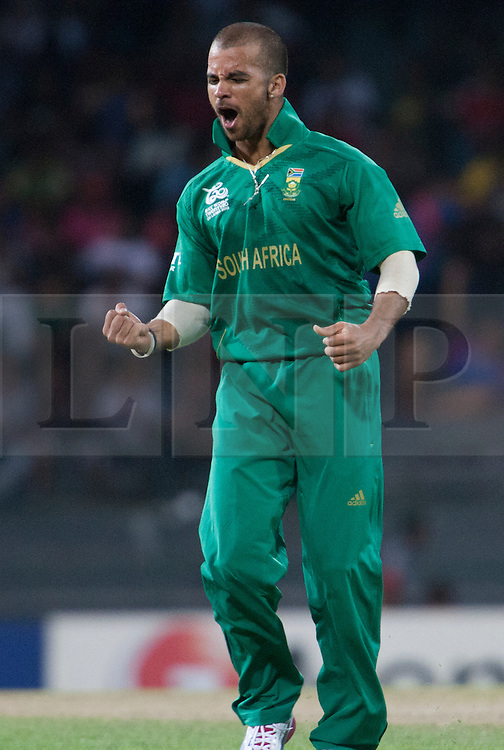 © Licensed to London News Pictures. 28/09/2012. South African bowler Jean-Paul Duminy celebrates after getting the wicket of Shahid Afrid for a golden duck during the T20 Cricket World cup match between South Africa Vs Pakistan at the R.Premadasa Cricket Stadium,Colombo. Photo credit : Asanka Brendon Ratnayake/LNP