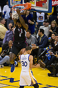 LA Clippers center DeAndre Jordan (6) hangs on the basket after a fast break against the Golden State Warriors at Oracle Arena in Oakland, Calif., on February 23, 2017. (Stan Olszewski/Special to S.F. Examiner)