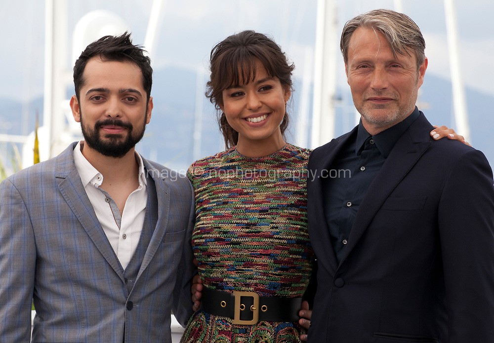 Director Joe Penna, Maria-Thelma Smáradóttir and Mads Mikkelsen at the Arctic film photo call at the 71st Cannes Film Festival, Thursday 10th May 2018, Cannes, France. Photo credit: Doreen Kennedy