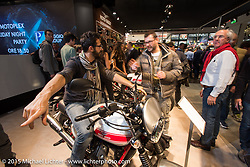 The Moto Guzzi Motorcycles booth during EICMA, the largest international motorcycle exhibition in the world. Milan, Italy. November 20, 2015.  Photography ©2015 Michael Lichter.