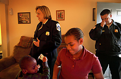 Police Chief Cathy L. Lanier visits the family of Sheila Tucker, 41, while on patrol in Washington, D.C. on March 16, 2009. Lanier took the Tucker family under her wing after meeting them on a call several years back. Lanier, chief of police with the Metropolitan Police Department of the District of Columbia, MPDC, rose to her position from humble beginnings: she was a high-school dropout after ninth grade and an unwed mother at the age of 15. Despite a rough start, she later earned advanced academic degrees from the Johns Hopkins University and the Naval Postgraduate School in Monterey, Calif., where she completed a Masters in Security Studies. Lanier also attended the John F. Kennedy School of Government at Harvard University and is a graduate of the FBI Academy and the University of the District of Columbia. She has been on the force for 18 years.