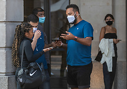 © Licensed to London News Pictures. 22/09/2020. London, UK. Apple Store staff wear face masks while serving customers in Covent Garden as the Government announce that all shop staff must wear face masks. Prime Minister Boris Johnson revealed today further tougher Covid restrictions with a 10pm curfew on pubs and restaurants, all shop staff to wear face masks and a £200 fine for not wearing a mask as a spike in coronavirus rates continues across the country. Photo credit: Alex Lentati/LNP
