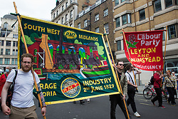London, UK. 26th June, 2021. Members of South West Midlands RMT join thousands of people attending a United Against The Tories national demonstration organised by the People's Assembly Against Austerity in protest against the policies of Prime Minister Boris Johnson's Conservative government. The demonstration contained blocs from organisations and groups including Palestine Solidarity Campaign, Stand Up To Racism, Stop The War Coalition, Extinction Rebellion, Kill The Bill and Black Lives Matter as well as from trade unions Unite and the CWU.