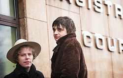 © under license to London News Pictures. 2/12/10 Pete Doherty (right) arriving at Bow magistrates court this morning (02/12/2010) to face charges of cocaine possession. Doherty was questioned by detectives investigating the suspected overdose death of heiress Robin Whitehead. Two of his friends also appeared on charges of cocaine possesion. Photo credit should read: Olivia Harris/ London News Pictures
