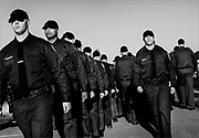 Recruits line up in formation during a daily morning physical training session held at the Monmouth County Police Academy in Freehold Township on October 1, 2013.