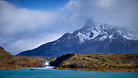 Lake, Mountains, Sky, Clouds and Waterfall in Torres del Paine National Park. Image taken with a Fuji X-T1 camera and Zeiss 32 mm f/1.8 lens.