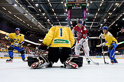 Puck between the legs of Dennis Karlsson at IIHF In-Line Hockey World Championships Top Division Bronze medal game between National teams of Canada and Sweden on July 4, 2010, in Karlstad, Sweden. (Photo by Matic Klansek Velej / Sportida)