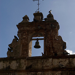 A bell above the entrance to the Parque de las Palomas in Old San Juan, Puerto Rico.