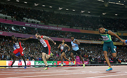 Turkey's Ramil Guliyev (second from left) dips on the finish line to win the men's 200m final during day seven of the 2017 IAAF World Championships at the London Stadium.