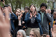 Crowd listen as Labour MP Dianne Abbott speaks to and takes questions from climate change activists from the Extinction Rebellion group at Parliament Square who are in protest that the government is not doing enough to avoid catastrophic climate change and to demand the government take radical action to save the planet, on 24th April 2019 in London, England, United Kingdom. Extinction Rebellion is a climate change group started in 2018 and has gained a huge following of people committed to peaceful protests. Diane Abbott is a British politician who has served as the Member of Parliament for Hackney North and Stoke Newington since 1987. She was the countrys first black MP as well as the longest serving black MP in the House of Commons.