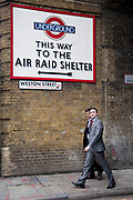 The Winston Churchill's Britain at War Experience is a themed museum located in central London, which recalls the London Blitz. Amongst the exhibits is a recreation of a London Underground air raid shelter. Two men pass an air raid shelter London underground sign.