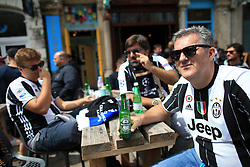 3rd June 2017 - UEFA Champions League Final - Juventus v Real Madrid - Juventus fans enjoy a beer before the match - Photo: Simon Stacpoole / Offside.
