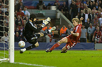 LIVERPOOL, ENGLAND - Tuesday, April 22, 2008: Liverpool's Dirk Kuyt scores the opening goal past Chelsea's goalkeeper Petr Cech during the UEFA Champions League Semi-Final 1st Leg match at Anfield. (Photo by David Rawcliffe/Propaganda)