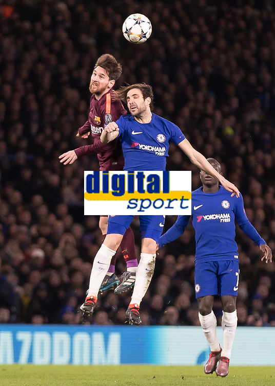 Football - 2017 / 2018 UEFA Champions League - Round of Sixteen, First Leg: Chelsea vs. Barcelona<br /> <br /> Cesc Fabregas (Chelsea FC)  and Lionel Messi (Barcelona) compete for the header at Stamford Bridge.<br /> <br /> COLORSPORT/DANIEL BEARHAM