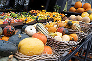 Local grocer 'Bora & Sons', a fruit and veg retailer, displays squashes, pumpkins, melons and other produce outside its high street business on Lordship Lane in East Dulwich, on 25th October 2021, in London, England.