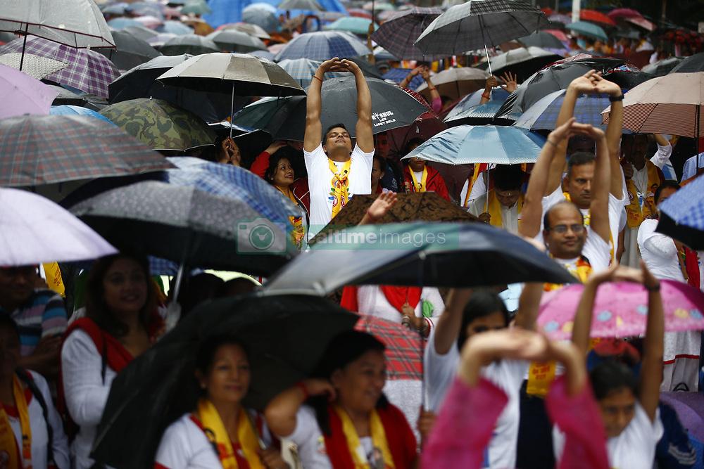 June 21, 2017 - Kathmandu, Nepal - People perform Yoga despite rainfall during International Yoga Day celebrations in Kathmandu. (Credit Image: © Skanda Gautam via ZUMA Wire)