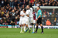 Swansea city's Gylfi Sigurdsson (23) celebrates with team mates after he scores his teams 1st goal to equalise at 1-1. Barclays Premier league match, Aston Villa v Swansea city at Villa Park in Birmingham, the Midlands on Saturday 24th October 2015.<br /> pic by  Andrew Orchard, Andrew Orchard sports photography.