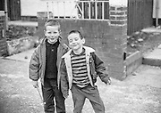 Boys clowning for the camera in West Belfast, Northern Ireland.
