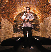 Lou Reed poses with his dog at Lit bar in NYC during an interview and cover shoot with the Strokes for Filter Magazine in 2004.