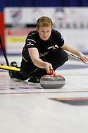 Carter Rycroft, second on Kevin Koe's team throws his rock in the team's first draw Wednesday.  The 2011 GP Car and Home Players' Championship ran April 12-17 at the Crystal Centre, Grande Prairie, AB..11-04-13, Photo Randy Vanderveen, Grande Prairie, Alberta.