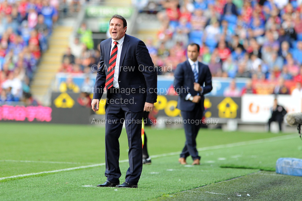 Cardiff city manager Malky Mackay shouts instructions.   Barclays Premier league, Cardiff city v Everton at the Cardiff city Stadium in Cardiff,  South Wales on Saturday 31st August 2013. pic by Andrew Orchard,  Andrew Orchard sports photography,