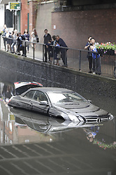 © Licensed to London News Pictures. 07/06/2016. London, UK. Cars submerged under water in Wallington, South London where torrential rain has caused flash flooding. Photo credit: Peter Macdiarmid/LNP