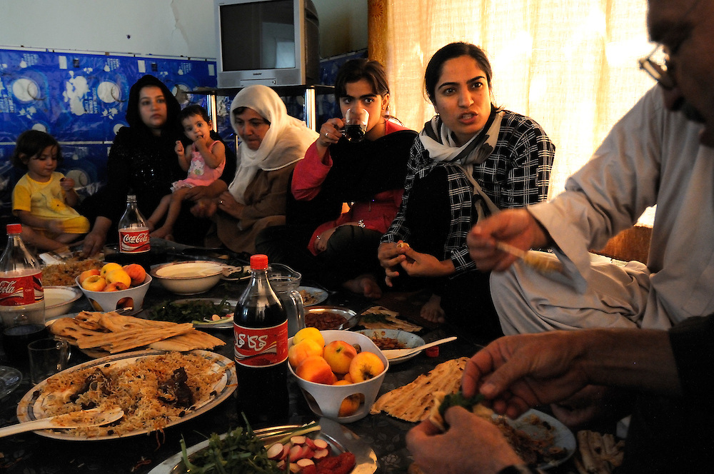 Malalai Joya eating lunch with friends.  She spends most days surrounded by supporters and armed guards in numerous safe houses in Afghanistan.  Joya electrified the nation in 2003 when she spoke out in the Afghan Parliament against warlords and criminals in the government.  She was suspended for this insult even though some fellow Parliamentarians who called for her to be raped and killed remain in government.  Joya has survived four assassination attempts and Human Rights Watch has called for her reinstatement to Parliament.