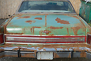 back side view an old rusty big American car