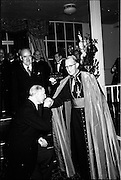25/07/1962<br /> 07/25/1962<br /> 25 July 1962<br /> Consecration Rev. Dr Grimley S.M.A. as Bishop of Cape Palmas, Liberia at the Pro Cathedral, Dublin. Picture shows  President Eamon de Valera kissing the ring of the newly consecrated Bishop, at a reception following the ceremony. Mr Frank Aiken, Irish Minister for External Affairs is also in the picture.