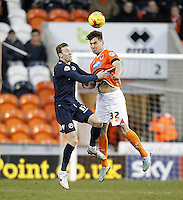 Blackpool's Grant Hall  jumps with Millwall's Martyn Woolford<br /> <br /> Photographer Mick Walker/CameraSport<br /> <br /> Football - The Football League Sky Bet Championship - Blackpool v Millwall - Saturday 10th January 2015 - Bloomfield Road - Blackpool <br /> <br /> © CameraSport - 43 Linden Ave. Countesthorpe. Leicester. England. LE8 5PG - Tel: +44 (0) 116 277 4147 - admin@camerasport.com - www.camerasport.com